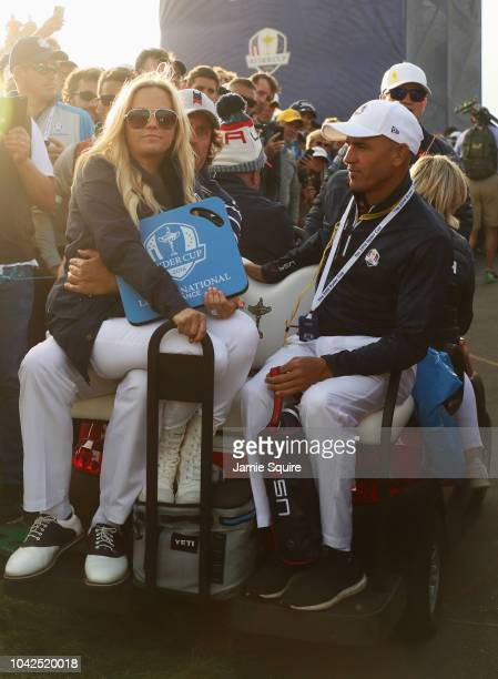Phil Mickelson of the United States and wife Amy Mickelson sit on a buggy during the afternoon foursome matches of the 2018 Ryder Cup at Le Golf...
