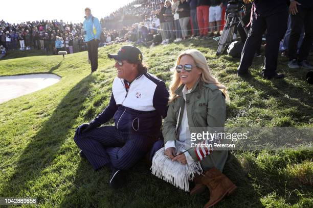 Phil Mickelson of the United States and wife Amy Mickelson watch on during the afternoon foursome matches of the 2018 Ryder Cup at Le Golf National...