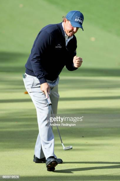 Phil Mickelson of the United States celebrates a putt for birdie on the tenth hole during the second round of the 2017 Masters Tournament at Augusta...