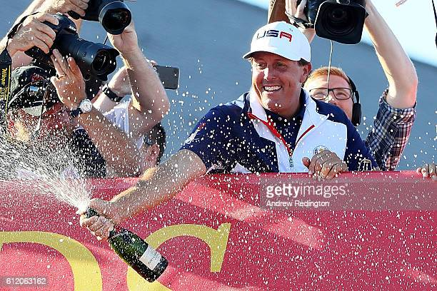 Phil Mickelson of the United States celebrates and sprays champagne after winning the Ryder Cup during singles matches of the 2016 Ryder Cup at...