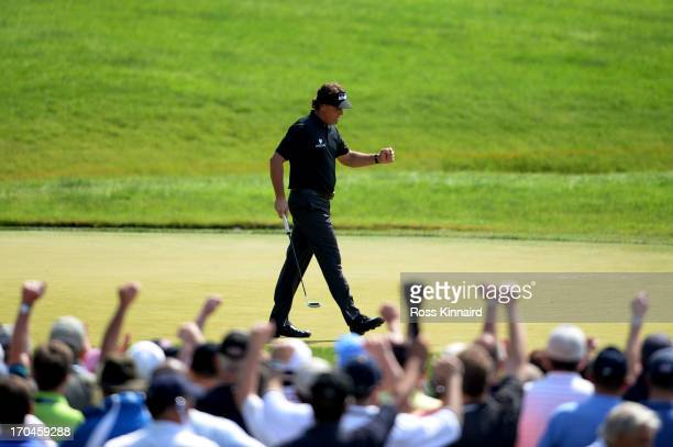 Phil Mickelson of the United States celebrates making a putt for birdie on the ninth hole during Round One of the 113th U.S. Open at Merion Golf Club...