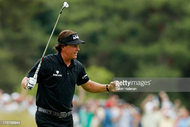 Phil Mickelson of the United States celebrates making a shot for eagle on the tenth hole during the final round of the 113th U.S. Open at Merion Golf...