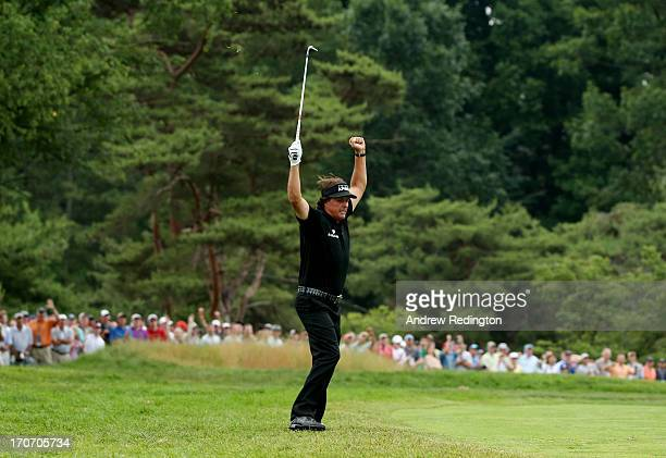 Phil Mickelson of the United States celebrates making a shot for eagle on the tenth hole par 4 during the final round of the 113th U.S. Open at...