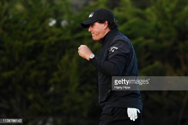 Phil Mickelson of the United States celebrates on the 13th green during the final round of the AT&T Pebble Beach Pro-Am at Pebble Beach Golf Links on...