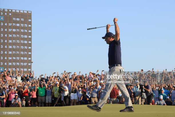 Phil Mickelson of the United States celebrates on the 18th green after winning during the final round of the 2021 PGA Championship held at the Ocean...