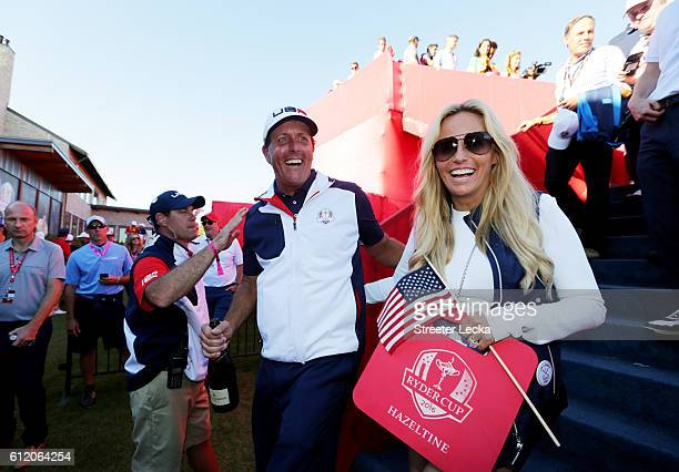 Phil Mickelson of the United States celebrates with Amy Mickelson after winning the Ryder Cup during singles matches of the 2016 Ryder Cup at...
