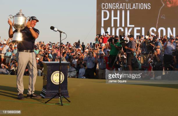 Phil Mickelson of the United States celebrates with the Wanamaker Trophy after winning during the final round of the 2021 PGA Championship held at...
