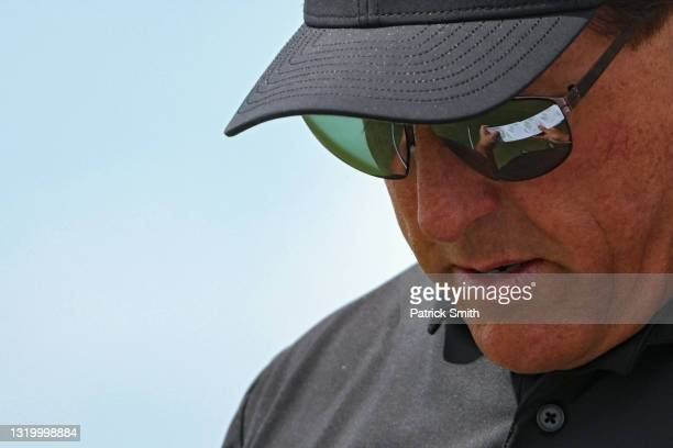 Phil Mickelson of the United States checks his yardage book during the third round of the 2021 PGA Championship at Kiawah Island Resort's Ocean...