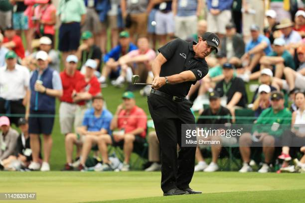 Phil Mickelson of the United States chips to the second green during the final round of the Masters at Augusta National Golf Club on April 14, 2019...