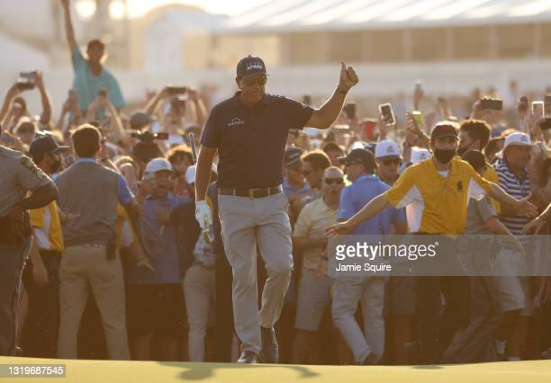 Phil Mickelson of the United States gives a thumbs up as he walks to the 18th green during the final round of the 2021 PGA Championship held at the...