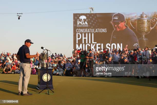 Phil Mickelson of the United States gives a thumbs up during the Wanamaker Trophy presentation ceremony after winning during the final round of the...