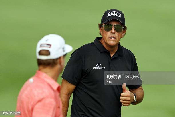 Phil Mickelson of the United States gives a thumbs up on the 18th green during the final round of the Travelers Championship at TPC River Highlands...