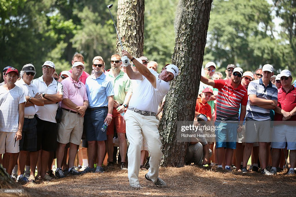 Phil Mickelson of the United States hits a shot from the pine needles on the second hole during the second round of THE PLAYERS Championship on The Stadium Course at TPC Sawgrass on May 9, 2014 in Ponte Vedra Beach, Florida.
