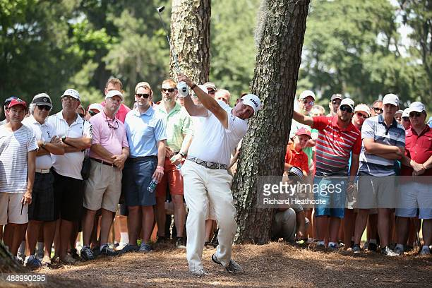 Phil Mickelson of the United States hits a shot from the pine needles on the second hole during the second round of THE PLAYERS Championship on The...