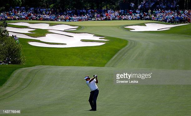 Phil Mickelson of the United States hits an approach shot on the fifth hole during the first round of the Wells Fargo Championship at the Quail...
