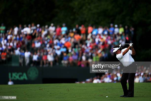 Phil Mickelson of the United States hits an approach shot on the eighth hole during Round Two of the 113th U.S. Open at Merion Golf Club on June 14,...