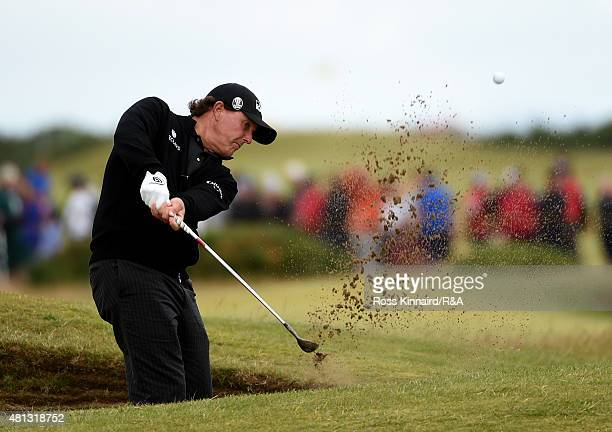 Phil Mickelson of the United States hits his second shot on the 16th hole from a bunker during the third round of the 144th Open Championship at The...
