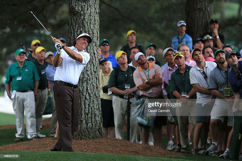 Phil Mickelson of the United States hits his second shot on the 17th hole during the first round of the 2013 Masters Tournament at Augusta National Golf Club on April 11, 2013 in Augusta, Georgia.