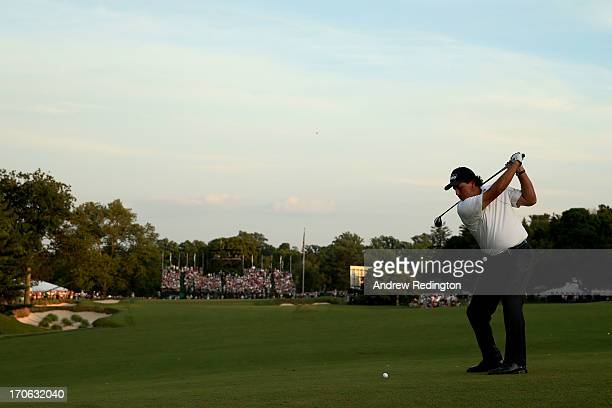 Phil Mickelson of the United States hits his second shot on the 18th hole during Round Three of the 113th U.S. Open at Merion Golf Club on June 15,...