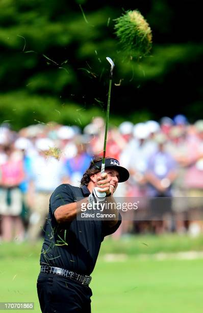 Phil Mickelson of the United States hits his second shot on the first hole during the final round of the 113th U.S. Open at Merion Golf Club on June...