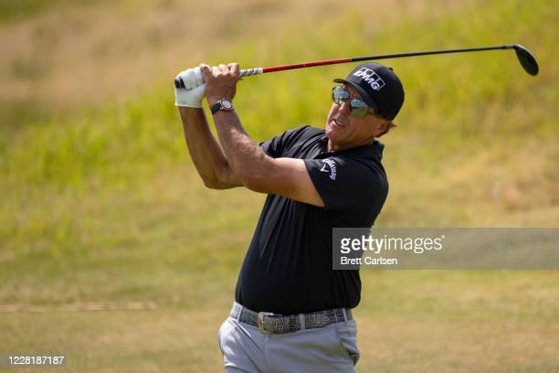 Phil Mickelson of the United States hits his tee shot on the fourth hole during round one of the Charles Schwab Series at Ozarks National on August...