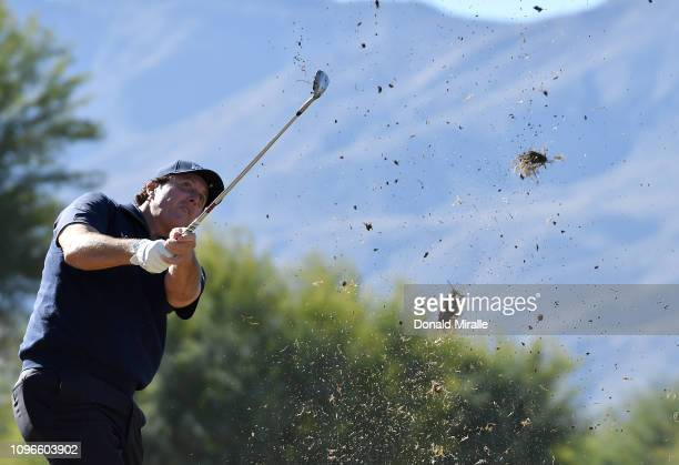 Phil Mickelson of the United States hits out of the rough on the 1st fairway during the third round of the Desert Classic at the Stadium Course on...