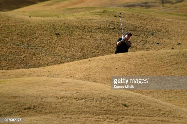 Phil Mickelson of the United States hits out of the rough on the 1st hole during the final round of the Desert Classic at the Stadium Course on...