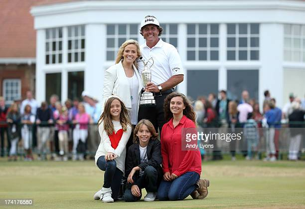 Phil Mickelson of the United States holds the Claret Jug wife Amy and children Evan Amanda and Sophia after winning the 142nd Open Championship at...