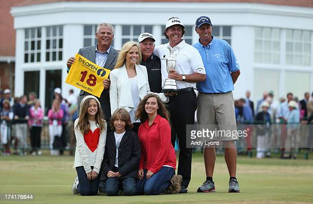 Phil Mickelson of the United States holds the Claret Jug wife Amy and children Evan Amanda and Sophiaformer coach Steve Loy coach Butch Harmon and...