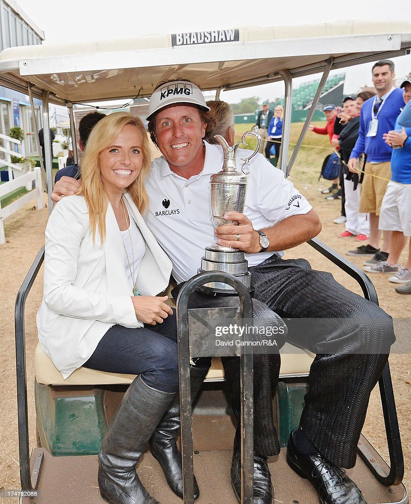 Phil Mickelson of the United States holds the Claret Jug with his wife Amy after winning the 142nd Open Championship at Muirfield on July 21, 2013 in Gullane, Scotland.