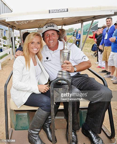 Phil Mickelson of the United States holds the Claret Jug with his wife Amy after winning the 142nd Open Championship at Muirfield on July 21 2013 in...