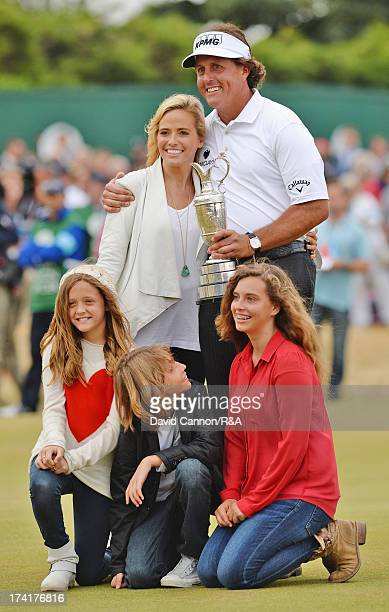 Phil Mickelson of the United States holds the Claret Jug with wife Amy and children Evan Amanda and Sophia after winning the 142nd Open Championship...