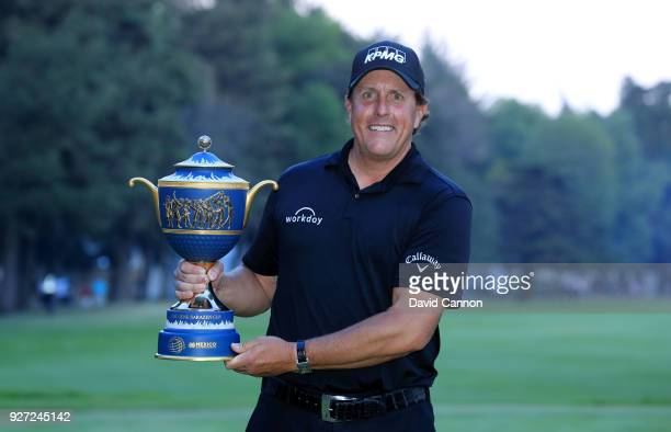 Phil Mickelson of the United States holds the Gene Sarazen Trophy after his playoff win during the final round of the World Golf ChampionshipsMexico...