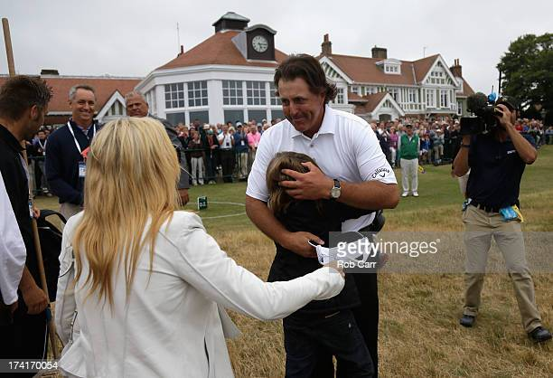 Phil Mickelson of the United States hugs one of his children as wife Amy comes over after Mickelson finishes the final round of the 142nd Open...