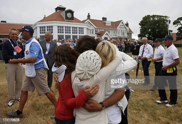 Phil Mickelson of the United States hugs wife Amy and children Evan Amanda and Sophia after finishing the final round of the 142nd Open Championship...