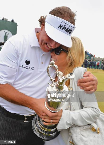 Phil Mickelson of the United States hugs wife Amy while holding the Claret Jug after winning the 142nd Open Championship at Muirfield on July 21 2013...