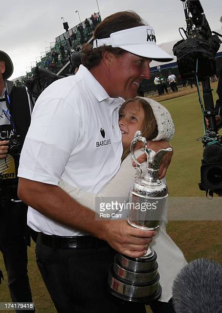 Phil Mickelson of the United States is hugged by daughter Amanda after winning the 142nd Open Championship at Muirfield on July 21 2013 in Gullane...
