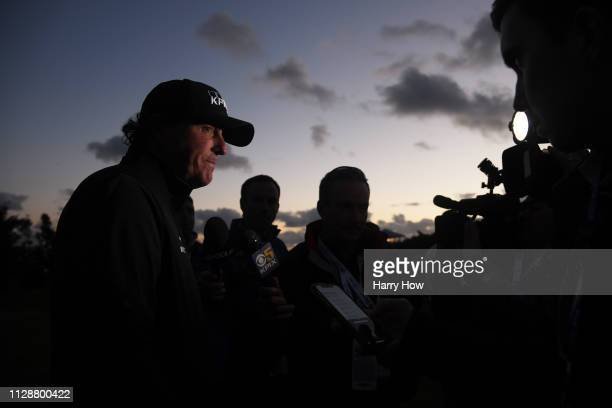 Phil Mickelson of the United States is interviewed after play was suspended due to darkness during the final round of the ATT Pebble Beach ProAm at...