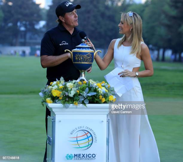 Phil Mickelson of the United States is interviewed by Ines Sainz of TV Azteca after his playoff win during the final round of the World Golf...