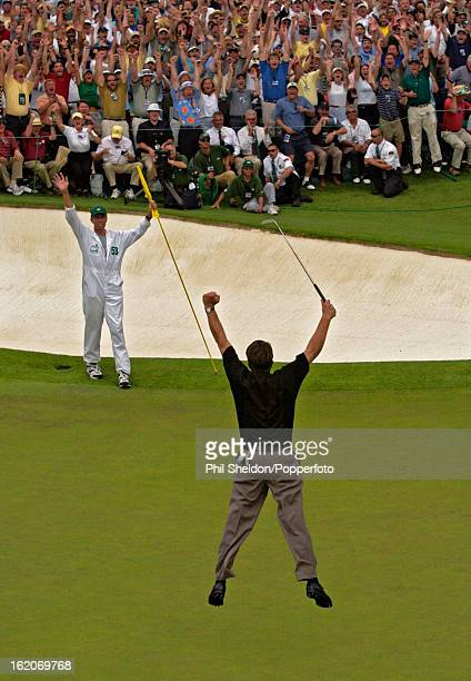 Phil Mickelson of the United States jumps for joy after winning the US Masters Golf Tournament held at the Augusta National Golf Club in Georgia on...