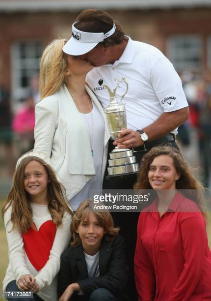 Phil Mickelson of the United States kisses wife Amy with children Evan Amanda and Sophia after winning the 142nd Open Championship at Muirfield on...
