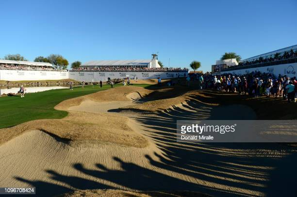 Phil Mickelson of the United States lines up his putt on the 18th green during the third round of the Desert Classic at the Stadium Course on January...