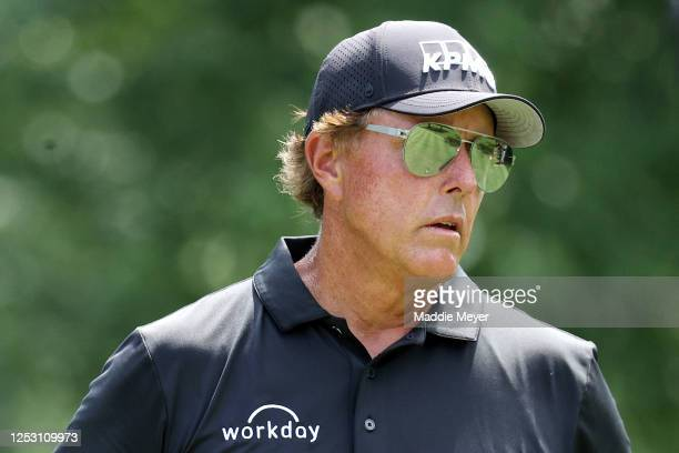 Phil Mickelson of the United States looks on from the seventh tee during the final round of the Travelers Championship at TPC River Highlands on June...