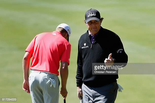 Phil Mickelson of the United States makes birdie on the fifth hole in front of Daniel Berger during the second round of the World Golf...