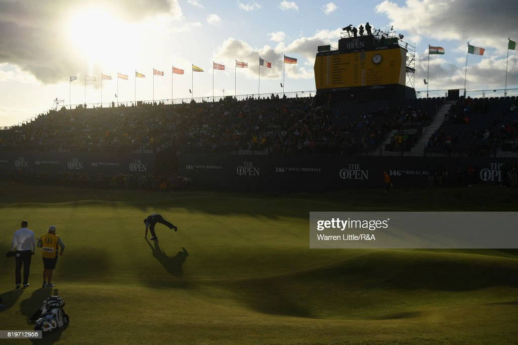 Phil Mickelson of the United States picks his ball from the hole on the 18th green during the first round of the 146th Open Championship at Royal Birkdale on July 20, 2017 in Southport, England.