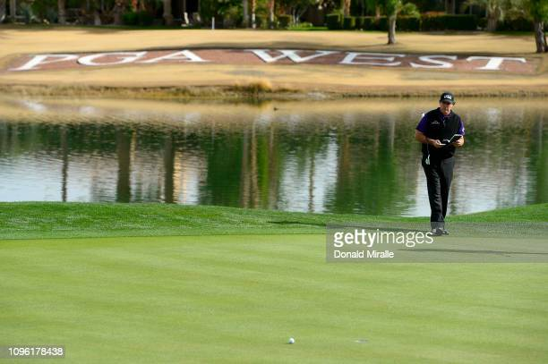 Phil Mickelson of the United States plans a shot on the 18th green during the second round of the Desert Classic at the Nicklaus Tournament Course on...