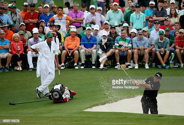 Phil Mickelson of the United States plays a bunker shot on the 15th hole during the final round of the 2015 Masters Tournament at Augusta National...