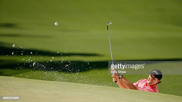 Phil Mickelson of the United States plays a bunker shot on the seventh hole during the third round of the 2015 Masters Tournament at Augusta National...