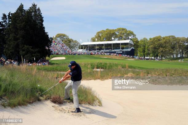 Phil Mickelson of the United States plays a shot from a bunker on the 18th hole during the second round of the 2019 PGA Championship at the Bethpage...