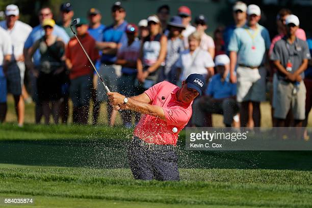 Phil Mickelson of the United States plays a shot from a bunker on the 12th hole during the first round of the 2016 PGA Championship at Baltusrol Golf...